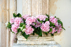 Decoration of flowers. Mauve flowers decorate a pillar Royalty Free Stock Images