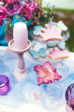 Decoration from flowers and cookies on the white table. Wedding, party decor. Royalty Free Stock Photography