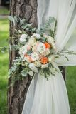 Decoration of flowers and fabrics of a wedding arch. Decoration of flowers and fabrics of wedding arch Royalty Free Stock Images