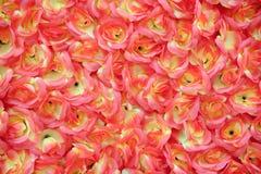 Decoration flowers. Red decoration flowers,silk fabrics, background Royalty Free Stock Photo
