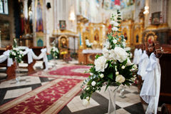 Decoration of flowers on vases at church on wedding ceremony. Stock Photo