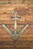 Decoration in form of an anchor. On wooden wall in restaurant stock images