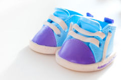 Decoration in the form of small toy shoes Stock Image