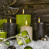 Decoration: four green and brown burning advent candles for chri Stock Photos