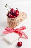 Decoration with fresh flowers and sweet cherry Stock Images