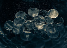 Decoration glass stones under water with air bubbles Stock Image
