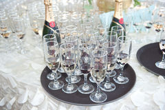 Decoration with glasses  and two bottles of champagne on festive table Stock Images