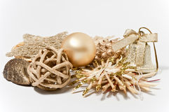 Decoration in gold. Christmas decoration in gold on white background Royalty Free Stock Photography