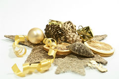 Decoration in gold. Golden christmas decoration on white Stock Photo
