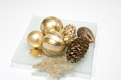 Decoration in gold. Christmas decoration in gold on white Stock Image