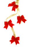 Decoration, gold ribbon with red bow Stock Images