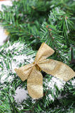 Decoration golden billow on new year tree branch Stock Photo