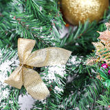 Decoration golden billow on new year tree branch. In snow Stock Image
