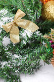 Decoration golden billow on new year tree branch. In snow Stock Photo