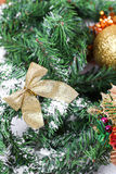 Decoration golden billow on new year tree branch. In snow Royalty Free Stock Photo