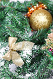 Decoration golden billow on new year tree branch. In snow Stock Photography