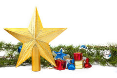 Decoration with green pine or fir and many gifts and gold star f Royalty Free Stock Photos