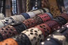 Decoration on hand. Hand made Wide leather bracelets royalty free stock photography