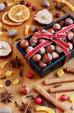 Decoration hazelnut in baking pan and mixed spices and dried fruits stock photos