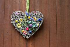 Decoration heart. With flowers and a wooden background Royalty Free Stock Photos