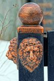 Decoration on the iron fence with the head of a lion Royalty Free Stock Photos