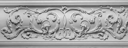 Decoration item made of white plaster. Relief stucco interior Stock Photos