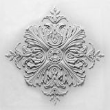 Decoration item made of white plaster. Relief stucco interior royalty free stock photo
