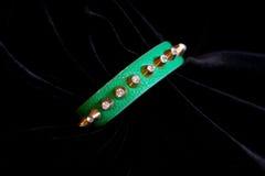 Decoration jewelery bracelet green. On a black background Royalty Free Stock Photography