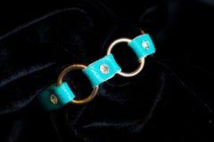 Decoration jewelery bracelet green. On a black background Stock Image