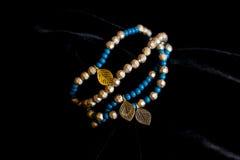 Decoration jewelery bracelet plastic stones. Decoration bracelet jewelry multicolored plastic stones black background Royalty Free Stock Photos