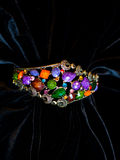 Decoration jewelery bracelet plastic stones. Decoration bracelet jewelry multicolored plastic stones black background Royalty Free Stock Photo