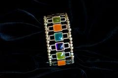 Decoration jewelery bracelet plastic stones. Decoration bracelet jewelry multicolored plastic stones black background Royalty Free Stock Photography