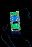 Decoration jewelery bracelet plastic stones. Decoration bracelet jewelry multicolored plastic stones black background Stock Photos