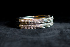 Decoration jewelry metal bracelet. On a black background Royalty Free Stock Photo