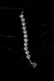 Decoration jewelry metal bracelet. On a black background Royalty Free Stock Photos