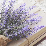 Decoration with lavender bunch upon vintage books bundle Royalty Free Stock Photo