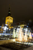 Decoration lights and old tall church in Tallinn Stock Photos