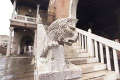 Decoration lion sculpture. Small sculpture of lion on handrails of buildin stairs in Venice, Italy royalty free stock photography