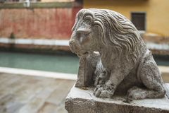 Decoration lion in Venice. Decoration lion sculpture on stone handrails in Venice, Italy stock image