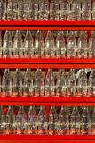 Decoration made of empty Coca Cola bottles. Coca-Cola, or Coke, is a carbonated soft drink produced by The Coca-Cola Company. Originally intended as a patent Stock Photography