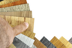 Decoration materials for home and building materials are natural. Materials. Samples of laminate and vinyl floor tile on wooden Background for new constuction Royalty Free Stock Photo