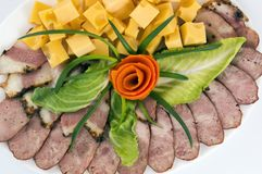Decoration of meat cuts of sausage, bacon and cheese, greens royalty free stock photos