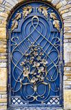 The decoration of the metal gate with beautiful forged elements.  Stock Photography