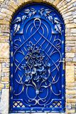 The decoration of the metal gate with beautiful forged elements.  Royalty Free Stock Photography