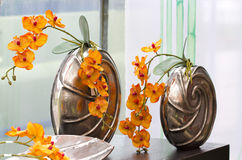 Decoration. A nice decoration from orchids adorn the window Stock Images