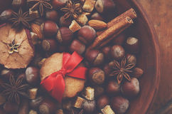 Decoration with nuts, dry apples, spices and gingerbread cookies Stock Images