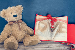 Decoration of old bear and vintage old book. Old bear and vintage old book Royalty Free Stock Image