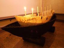 Decoration with old wooden boat and candle in the church of Herisau royalty free stock photo