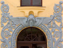 Decoration over the Entrance of an Art Nouveau Palace in Riga Royalty Free Stock Photo