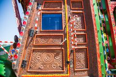 Wooden door of a pakistani truck. Decoration pakistani truck art artist paint painter flower heart culture wheels auto bedford punjab jingle concept idea birds royalty free stock image